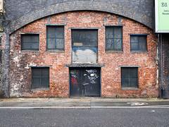 Ed (Peter.Bartlett) Tags: manchester ricohgr window unitedkingdom brick facade doorway colour lunaphoto shutter urban uk wall urbanarte doubleyellowlines peterbartlett sign graffiti city door