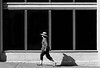 Undercover (Ian Sane) Tags: ian sane images undercover woman hat walking uphill shadow lines windows burnside street black white candid photography portland oregon canon eos 5ds r camera ef70200mm f28l is usm lens