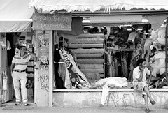 Shopkeepers. (L_u_c) Tags: noiretblanc noirblanc blackwhite blanconegro blanconigro blackandwhite streetphotography streetshot street strada streetscene streetfoto people gens gente man men shop shopping shopkeeper nikond300s nikon monochrome monotone outside outdoors extérieur exterior bw nb