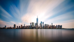 The City is Beaming (Gary Walters) Tags: smoothreflections nyc wtc newyork landscape manhattan longexposure financialdistrict water sony newjersey cityscape skyline a7r sel1635z downtown magic
