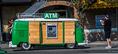 2017 - Vancouver - Mobile Cash (Ted's photos - For Me & You) Tags: 2017 bc britishcolumbia canada cropped nikon nikond750 nikonfx tedmcgrath tedsphotos vancouver vancouverbc vancouvercity vignetting vw vwvan volkswagen van wheels hubcaps people peopleandpaths photographer sunglasses trg trgcommercial solar solarpanel antenna atm automatictellermachine cashdispenser shadows streetscene street cashmachine logo cans2s