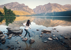 Stepping Stones (Kevin Dinkel) Tags: phelps grand peaceful girl water mountains balance national lake reflection serene rocks mountain morning blue brunette calm beautiful step walk trees jackson movement green sunrise park wyoming teton
