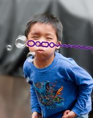 Blow, Josh! (martiecl) Tags: bubbles blow wand breath breathe boy effort