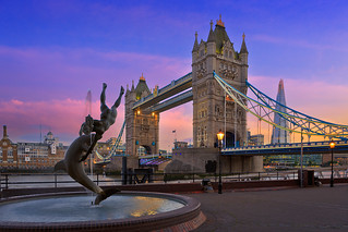 Tower bridge and girl with dolphin