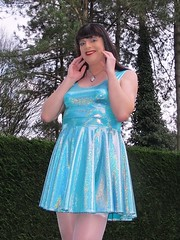 Sparkly pleasure (Paula Satijn) Tags: sexy hot girl blue dress smile happy fun garden shiny sparkly sparkles skirt miniskirt skater legs stockings joy feminine tgirl transvestite tranny spandex holographic