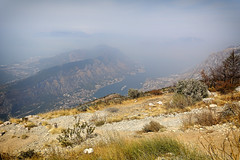 Kotor Bay In The Mist (Alfred Grupstra) Tags: mountain nature landscape scenics outdoors sky hill summer tree blue mountainpeak forest rockobject beautyinnature mountainrange travel valley grass meadow nopeople kotor tivat kotorbay montenegro