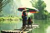 (Wojtek Zet) Tags: bamboo rafting river yangshuo raft umbrella people green china september 2017 water