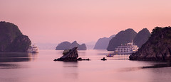 The dragons descend (ajecaldwell11) Tags: halongbay sunrise ankh purple water xe2 fujifilm clouds tide pink islands southeastasia sky boat vietnam caldwell dawn light
