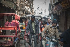 Busy street... (Syahrel Azha Hashim) Tags: portrait nikon street shallow holiday pc9 simple scooter indian details portraiture busystreet local tricycle dof bokeh market vespa expression scene people olddelhi streetphotography 2015 vacation handheld rajasthan light india naturallight moment colorful photojournalism d300s travel syahrel 35mm prime colors colorimage streetmarket getaway humaninterest detail