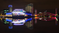 The ever changing colours of Salford Quays (G-WWBB) Tags: cityscape night lights lowrysalfordquays lowry lowrybridge lowrytheatre millenniumbridge millenniumfootbridge salfordquaysmillenniumfootbridge salfordquaysliftbridge liftbridge reflections reflect reflecting waterfront water skyline salford salfordquays bridge canal red blue purple colours