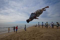 At Marina, Chennai (Ravikanth K) Tags: 500px acrobatics people student free style jump motion air freeze above clouds sky marina beach chennai india cwc chennaiweekendclickers gymnastics outdoor street cwc609