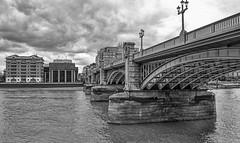 FT Building and Southwark Bridge. (MWBee) Tags: southwarkbridge london riverthames water river bridge lamps flags span clouds stormclouds monochrome blackandwhite ftbuilding nestcorporationbuilding bankside mwbee nikon d5000