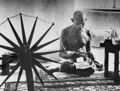 Mohandas K. Gandhi (urcameras) Tags: 20th best century independence india indian famous floor foreground gandhi leader life looms picture print mohandas reading next select sits spinning struggle symbol home he textiles vintage weaving wheel 245446 timeincown