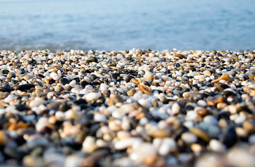 A beach of colourful pebbles at the shore of Black Sea, in Evpatoriya, Crimea