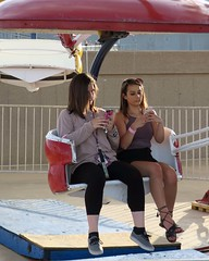 Cell phone Sisters (BarryFackler) Tags: tasteofomaha tasteofomaha2017 fair carnivalride thrillride girls teenagers paratrooperride paratrooper cellphone phone texting teenagegirls sisters youngwomen outdoor ride omaha midwest nebraska park omahanebraska omahane sunglasses barryfackler barronfackler 2017 katiefellbaum katie katielynnfellbaum ashley ashleyfellbaum ashleymariefellbaum vacation lewisclarklanding riverfrontpark