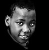 hope for our future .... (daystar297) Tags: streetportrait portrait availablelight black africanamerican boy kid beautiful headshot nikon d90 bw blackandwhite monochrome nikonnikkor18200vr