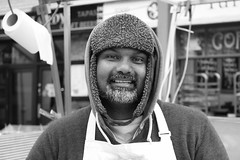 A warm (and charming) market trader from Greenwich, London.... (markwilkins64) Tags: portrait street hat greenwich london market blackandwhite monochrome bw canon mono