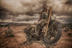 Despatch Rider (brian_stoddart) Tags: motorcycle motorcyclist aircraft sky clouds desert tint composite military vintage old