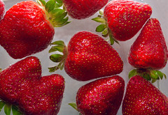Inviting Imperfection (DaveLawler) Tags: mutation strawberry strawberries red snack delicious food fruit seeds mutant water floating