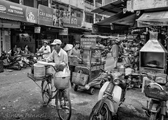 The Street Vendor 3 (simon_pannell) Tags: southvietnam saigon blackandwhite asia street southeastasia nikdefine seasia vietnam colour streetscapes monochrome travel hcmc niksilverfx streetlife hochiminhcity