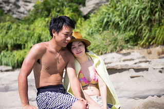 Young couple leaning each other on beach
