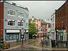 Wet Cowes (Jason 87030) Tags: weather rain wet puddles bunting red white blue green orange splash drench cowes higstreet shops coffeewalnutcake cafe coffee august holiday water 2017 iow island isleofwight people shoppers architecture grim gloomy awful dreadful scene view elements brolly umbrella