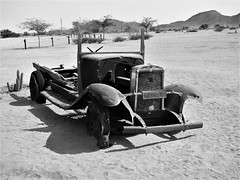 Namibia's Beauty:  Solitaire ... a very old truck (ronmcbride66) Tags: namibia namibiasbeaty solitaire wreckedlorry desert mountains namibnaukluft cactus