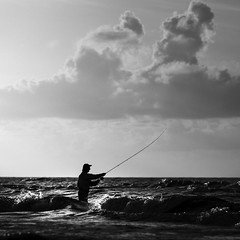 Surfside Fisherman (Mabry Campbell) Tags: 2012 brazoriacounty freeport gulf gulfofmexico houstonphotographer surfside surfsidebeach tx texas us usa unitedstatesofamerica blackandwhite fineart fineartphotography fisherman fishing image man morning person photo photograph photography sport squarecrop sunrise water f45 mabrycampbell july 2017 july272017 20170727campbellh6a6058 100mm ¹⁄₂₀₀sec 100 ef100mmf28lmacroisusm fav10