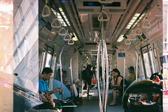 Afternoon commute (hopeflowpj) Tags: 35mm film filmphotography filmsnotdead filmisnotdead folk filmlab fujifilm fujixtra400 canon canonet sunset outdoors canonetql17 rangefinder fuji people street doubleexposure mx multipleexposure sun train