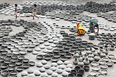Pottery work! (ashik mahmud 1847) Tags: pottery bangladesh d5100 nikkor potterywork woman children kids pattern group travel travelphotography