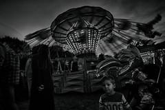 funfair (amazingstoker) Tags: carters strem fair war memorial park basingstoke basingrad amazingstoke mono dark flying chairs eerie carousel monochrome black white sinister low key chairoplane dystopia dutch angle tilt