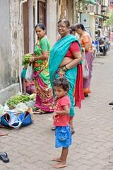 Buying fruit, Mumbai (Yekkes) Tags: asia india mumbai bombay street urban people women child sari barefoot thoughtful shopping