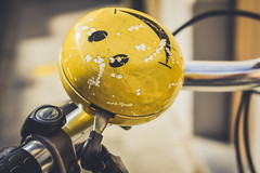 Smiling bell (*mirt) Tags: bell smile smiley yellow bike black happy dof depthoffield closeup 7dwf monday freetheme