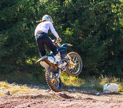 Behind Rider X (John Kocijanski) Tags: motorcycle motocross canon70300mmllens vehicle dirtbike people race sport canon7d jump