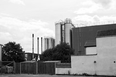 Pasta Factory (Number Johnny 5) Tags: lines tamron d750 building industrial vertical topographic flag noir mundane factory banal yarmouth bnw great monochrome subjectivelyobjective silo 2470mm nikon black chimney bw angles norfolk white