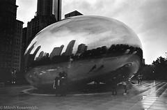 Soggy City In Monochrome -  (10 of 11).jpg (Milosh Kosanovich) Tags: cloudgate block37 statestreet chicago bean bw bwfilm minoltax700 kodaktmax400 film wet millenniumpark chicagophotographicart epsonv750pro night chicagoist chicagophotographicartscom miloshkosanovich mickchgo macys chicagophotoart minolta50mmf14 rain kodak400tmax