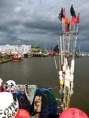 Norway in Steveston (Szymek S.) Tags: buoys floats traps poles boat fishingboat fishboat lofoten harbour port steveston richmond cannery gulfofgeorgiacannery river fraserriver britishcolumbia canada buoyant