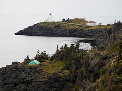 A distant view of the Swallow Tail Lighthouse from my campsite on Grand Manan Island (Bay of Fundy), New Brunswick (Ullysses) Tags: holeinthewallparkcampground grandmananisland newbrunswick bayoffundy canada summer été camping lighthouse northhead phare swallowtaillighthouse