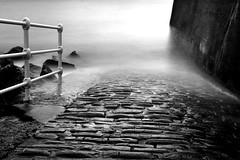Descent (2nd Sight Photography) Tags: sea ramp descent descend water drown cobbles light dark shade railing coast coastal seascape bw monochrome madness longexposure neutraldensity canon 400d oldimage reedit 2ndsightphotography devon