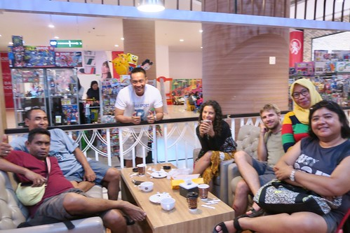 With friends in Kupang. Eating Kangkung Cah Bunga Pepaya (papaya flower), Nasi Se'i Babi  (Rice with smoked pork), bananas on the street and having some drinks at Pantai Koepan beach - 999 Resto & Bar, etc.  West Timor, Indonesia