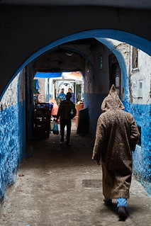 Morrocan man in djellaba walking in medina, Tétouan, Morocco