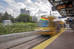West Bank Station (Sam Wagner Photography) Tags: west bank station riverside plaza unique architecture trains lightrail mass commuter commute stop platform metro transit transportation long exposure motion blur sunny dramatic clouds summer afternoon minneapolis minnesota midwest st paul bound east green line
