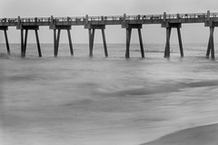 Surf & Pier (S&L Smith) Tags: florida pensacolabeach blackwhite gulfofmexico waterscape beach kodak tmax100 minoltadimageeliteii