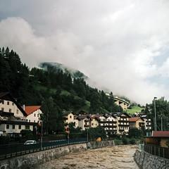 (Boris Zhigun) Tags: eurostars tyrol alps austria mountains forest trees landscape buildings overpass trucks water river dirt sky clouds волна3 volna3 среднийформат mediumformat 120film kodak portra400 pentaconsix p6 matrei am brenner 6x6
