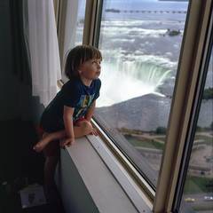 (patrickjoust) Tags: 120 6x6 medium format chrome slide e6 color reversal expired discontinued film manual focus analog mechanical patrick joust patrickjoust people person fujifilm gf670 fujichrome astia 100f rangefinder llewelyn boy kid portrait niagara falls ontario canada north america tower hotel waterfall view river room