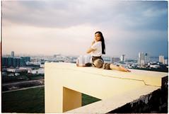 (grousespouse) Tags: vietnam 35mm hcmc saigon analog film nikonf3 nikonseriese 28mm wideangle kodakultramax400 portrait rooftop yoga croplab grousespouse hochiminhcity vietnamese girl analogue