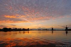 Sunset at river De Zaan (Johan Konz) Tags: zaanseschans zaandijk netherlands watercourse river dezaan windmills sunset sky polder kalverpolder outdoor nikon d90 dusk water waterfront serene landscape skyline clouds reflection