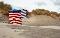 Strandzelte (Kamerakata) Tags: canon a1 200 epsonv600 kodak gold c41 lenstagger borkum sand nopeople red outdoors beach sky blue sanddune striped day nature