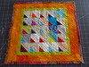 Tropical Liberated Triangles by Janie 2017 (crazyvictoriana) Tags: small quilt cotton batik kona hand quilted triangles liberated modern traditional medallion prints handquilted