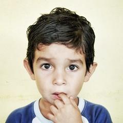Will it hurt? (Pejasar) Tags: honduras seisdemayo fingerinmouth firsttime student fearful portrait child boy